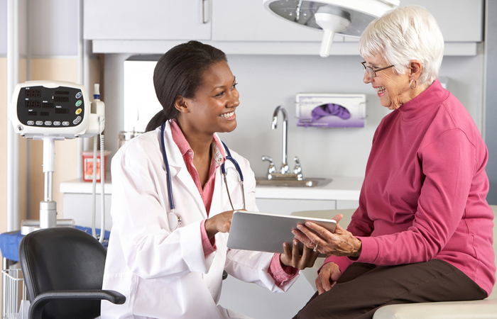 HSHS - Young doctor smiling at elderly woman