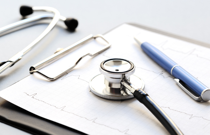 HSHS - Stethoscope sitting on clipboard next to pen