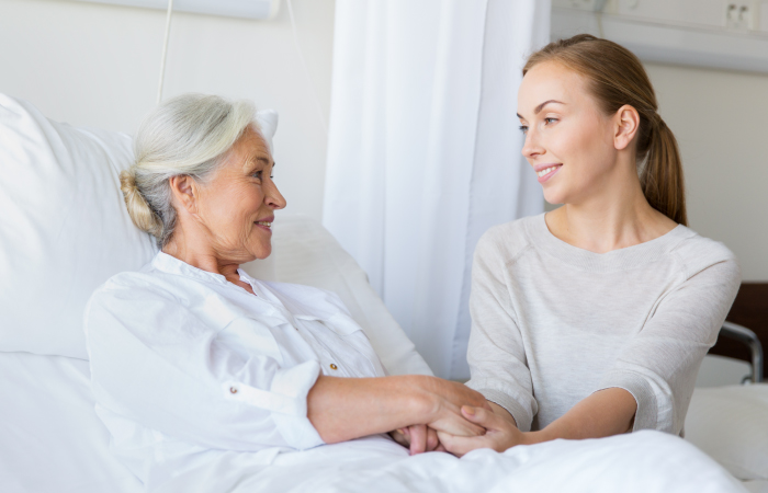 Sacred Heart_Patient Rights & Responsibilities Home Page_guest talking to elderly patient
