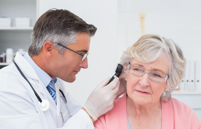 St Josephs Breese Services Audiology Doctor looking in patient ear
