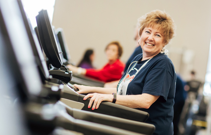 St. Joseph Highland - woman walking and smiling on treadmill promoting heart health