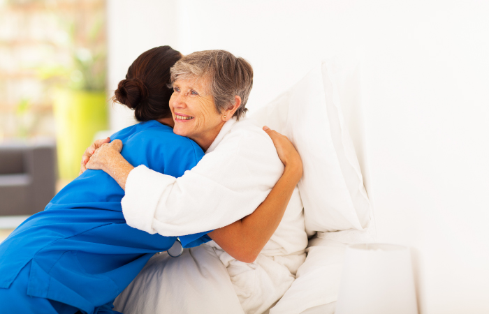 St. Joseph Highland - elderly woman hugging nurse